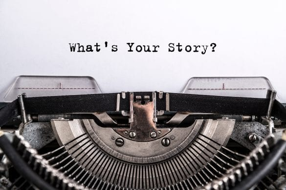 typewriter with 'what's your story?' text